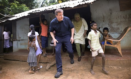 David Cameron meets Tamil refugees in the Sabapathy Pillai refugee camp in Jaffna, northern Sri Lanka. Photograph: Stefan Rousseau/PA